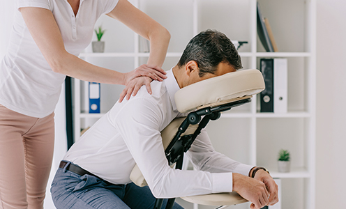 Staff getting massage at workplace